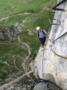 The author's wife ascending a Via Ferrata in the French Alps
