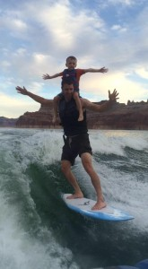 My nephew and I riding the wave behind The North Shore (aka the boat this blog bought me)